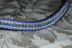 Equiture - Aquamarine, iridescent and sapphire curve megabling browband, $115.37 (http://www.equiture.biz/aquamarine-iridescent-and-sapphire-curve-megabling-browband/)