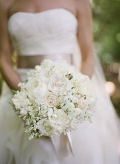 White Wedding Bouquet. Maybe add some light purple to this. I like the look of this one though.