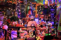 There's tons of potential for upcycling party favors, other holiday leftovers and all kinds of colorful, decorative paraphernalia into a Dia de los Muertos altar.