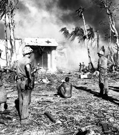 US Marines after the Battle of the Marshall Islands guarding their POW in Namur, 2 February 1944.