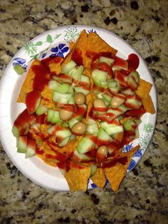 Doritos, cucumber, Japanese nuts, and chamoy chile sauce.
