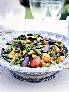 A mixture of fresh herbs is used in place of lettuce for this vegetable side salad.