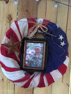 Took an old wreath and an old banner shaped flag and wrapped it. Tied with craft straw, added a star & a pic of my son. I put this on display for his graduation/going away party before he left for boot camp. ❤️