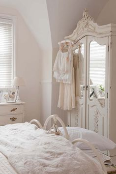 Beautiful Armoire with Crisp whites and ivory tones.
