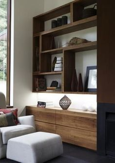 Raw wood shelves with under mounted lighting. Sets a low key mood. Calming