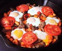 A delicious and easy breakfast skillet made with sweet potato, onion, peppers, steak, eggs and tomatoes. Paleo, Whole30 and 21DSD.