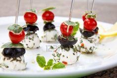 Mozzarella cheese, black olives, cherry tomatoes and oregano served with lemon