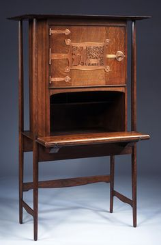 (Charles Francis Annesley) C.F.A. Voysey (1857–1941) - Writing Desk. Unstained Oak with Copper Panel and Hardware. England. Circa 1896. Designed for the William and Haydee Ward-Higgs Home in Bayswater, London. Victoria and Albert Museum, London, England.