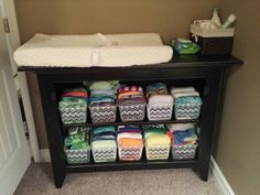 Cloth diaper storage and organization. $2.00 plastic tubs from Walmart