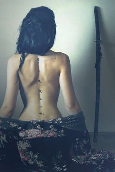 spiritual Chakra tattoo on back