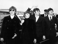 The Beatles, waving to screaming fans en route to Boston airport, America, from left to right, George Harrison, Ringo Starr, John Lennon and Paul McCartney, on August 12, 1966. Daily Express/Archive Photos/Getty