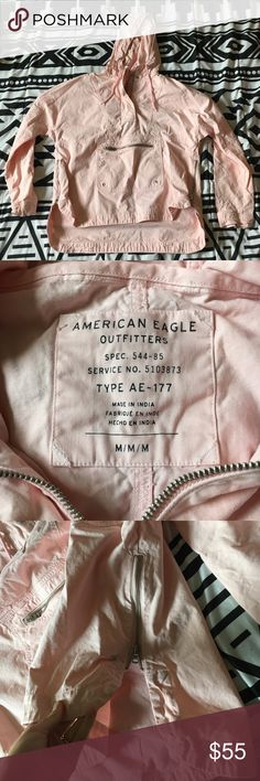 AEO Jacket Very unique item! Baby pink jacket from American Eagle. Features side zippers, a zippered kangaroo pouch, zipper & button at the neck, drawstring hood. Worn and washed once. I LOVE this jacket, but I wish I got it in a L. I just feel like it fits my body weird. My loss, your gain! American Eagle Outfitters Jackets & Coats