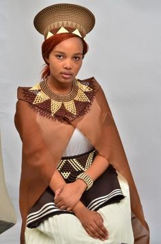 Xhosa woman in her Xhosa traditional attire   - Explore the World with Travel Nerd Nici, one Country at a Time. http://TravelNerdNici.com