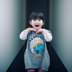 Little Asian girl = cute as a button.