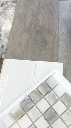 Cabinetry gray/brown and white with this backsplash!