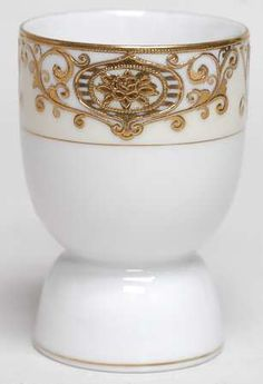 """Double egg cup in the 175 pattern by Noritake. """"Double egg cups"""" may be one of two things-- a two headed one made for two eggs, or a double-sided cup like this one."""