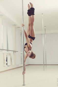 Pole dancing - a new hit craze! Spectacular body strength and grace.