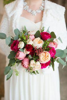 Winter wedding bride's bouquet. Flowers include pink darcey garden roses, peach juliet garden roses, blush majolica spray roses, burgundy spray carnations, pepperberry, silver dollar eucalyptus by www.redpoppyfloral.com