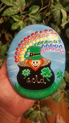 Leprechaun Loves His Gold painted rock Artist: Anita Schmidt