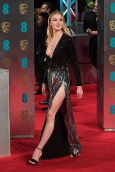Actress Sophie Turner served up some major leg with this sequined plunging gown at the 70th Annual BAFTAs in London.