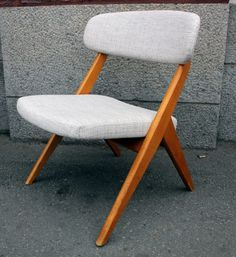 Finnish Bambino chair by Ilmari Lappalainen. Was manufactured by Asko in 1955-1957.   Photo from Kätkö Vintage: http://shop.katkovintage.fi/epages/katkovintage.sf/fi_FI/?ObjectPath=/Shops/20121124-11092-168768-1/Products/1010.   Price of the chair 550 euros.