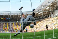 USA's goalkeeper Hope Solo saves a ball during the quarter-final match of the FIFA women's football World Cup Brazil vs USA on July 10, 2011, in Dresden, eastern Germany. The USA won the match after a penalty shoot-out.