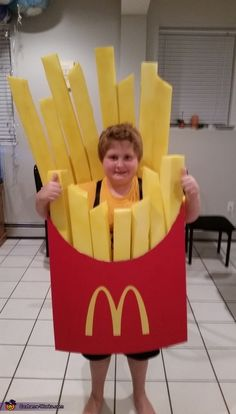 Pamela: This is my son, Hunter. He wanted to be French fries for Halloween. I took two red display boards, shaped them and attached them. I printed the M and cut...