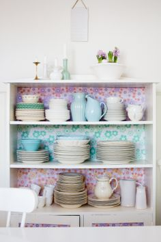 Antique dishes in a recycled cabinet.  Great color and pattern combos.