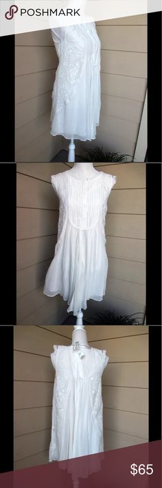 Anthropologie White Madrid Swing Dress-HD in Paris NWOT. Beautiful white swing dress with embroidery detail. Never worn.  Viscose material, hand wash. Anthropologie Dresses Mini