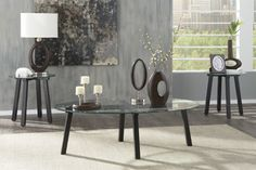 Oval Glass Coffee Table This table comes with a set of round glass top end tables for a complete modern set of occasional tables. Perfect for a sleek and beautiful living room