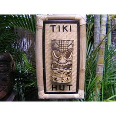 """Here is a hand made bamboo """"Tiki Hut"""" sign. It is hand made, bamboo framed, and backed with a woven mat. Specifications: - Wood: bamboo frame - Woven mat - Size: X - Ready to hang Very Tropical and Polynesian decor!"""