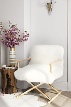 "Jodi White Sheepskin Chair Details Meet Jodi- the fabulously fluffy, glamorous in gold and perfectly poised director chair. We love how Jodi's genuine sheepskin fur adds texture to a classic frame. Place Jodi at a desk, next to your bed or in the hall as that statement piece you've always been searching for. - Color: white - 26"" W x 27.8"" D x 32.7"" H - Imported $1,695 (on sale for $782)"