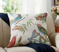 Fauna Print Botanical Pillow Cover with birds and butterflys and matching napkins for the great room.