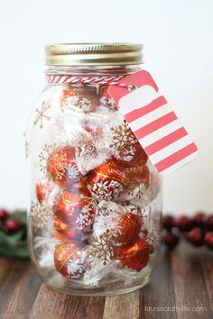 Snowflake Gift Jar - mason jar + vinyl snowflakes cut with the Cricut