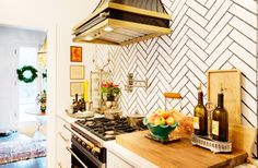 Colleen Locke's kitchen is small and perfect. We showcased this home decked out for Christmas, but the photos of the kitchen provide year-round inspiration. Part of StyleBlueprint's 17 Beautiful White Kitchens on StyleBlueprint. Each of these kitchens features white cabinets and will make you swoon!