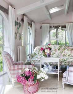 I love the wall color, not to mention the PINK buffalo check covered chairs!