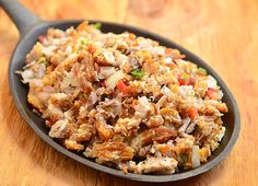 A crispy sisig made with chopped lechon kawali, bell peppers, chilies, onions and calamansi