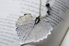 Large Fallen Silver Cottonwood Leaf Necklace by EnchantedLeaves.com  Real Cottonwood Leaf that has been electroplated in silver. Perfect for fall weddings! #realleaf #silverleaf #fallwedding #weddingjewelry #silver #bridesmaids #fallleaf