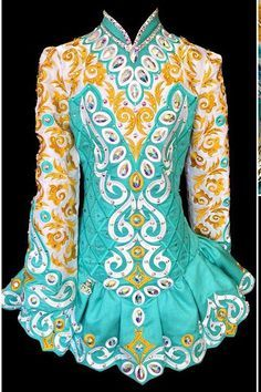 Irish dance dresses 2016 - skirt is combination of pleats & gathering, pretty sure this is all one piece; embroidered & beaded.