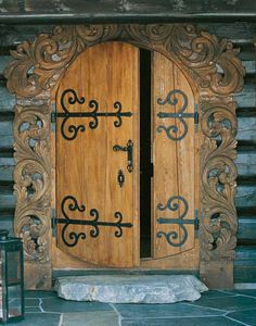 Norwegian mountain cabin door with beautiful, traditional and handmade wood carvings and floral paintings (rosemaling) from the county of Telemark.
