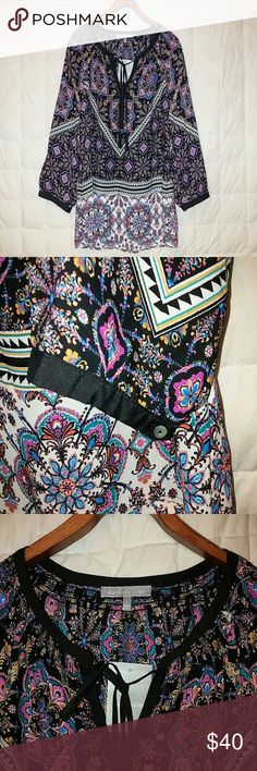 Daniel Rainn hippie peasant blouse with tassels V-neck blouse with neckline trimmed in black accented with tassel ties.  3/4 sleeves with button closures.  Gathered detailing along collar and neckline.  Flowy chiffon like fabric. Brand new condition with original manufacturer's tags attached. Daniel Rainn Tops Blouses
