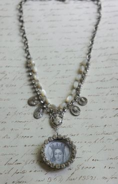Madonna-Vintage assemblage necklace vintage medals, rhinestones and mother of pearl beads by frenchfeatherdesigns on Etsy