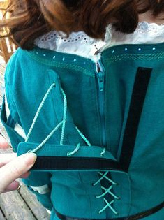 sneaky hack for making a drawstring closure on a child's costume a little easier to get in and out of. Found it here: http://thingsweeks.blogspot.com/2012/10/merida-dress-long-version.html