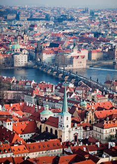 De Charles Bridge connects de Lesser Old Town to de rest of de capital city in Prague, is situated on de Vltava River in Central Bohemia_ Czech Republic