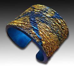 Adriana Allen | Sapphire and gold polymer clay cuff bracelet via Etsy.