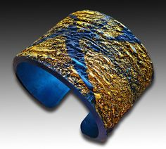 Adriana Allen | Sapphire and gold polymer clay cuff bracelet via Etsy.
