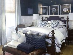 Something so peaceful about a white room with navy accents