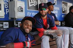 Dustin Pedroia and Pablo Sandoval of the Boston Red Sox are seen prior to the Opening Day game...