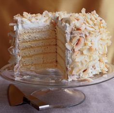 WOW! what a cake to make is this six layer coconut cake with that passion fruit filling , certainly a entertaining cake that will impress any guest I am sure When I found this recipe …