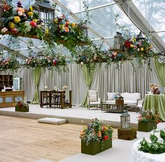 A faux sunken dance floor and the most perfect hanging floral arrangements! Love this tented reception. Photo: A Bryan Photo / Event Planning & Design: Mariee Ami / Floral Design, Event Design: Wildflower Designs